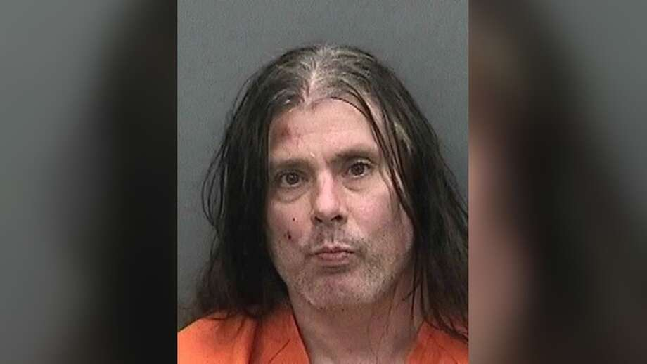 Pat O'Brien, lead guitarist for the death metal band Cannibal Corpse, was arrested Monday for allegedly assaulting a police officer and burglary in Northdale, Fla., a Tampa suburb. O'Brien's house caught fire shortly before the burglary report at a neighbor's house. Photo: Hillsborough County Sheriff's Office