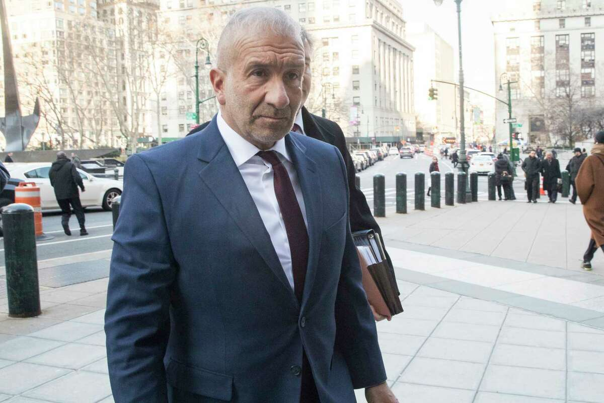 Alain Kaloyeros, the ex-president of the State University of New York's Polytechnic Institute, arrives for his sentencing at Manhattan Federal court, Tuesday, Dec. 11, 2018, in New York. Kaloyeros, who led the Polytechnic Institute until he resigned in October 2016, was convicted in July of conspiracy and wire fraud after prosecutors presented evidence that the bidding process for a state project was rigged to benefit a Buffalo developer and a Syracuse development company.