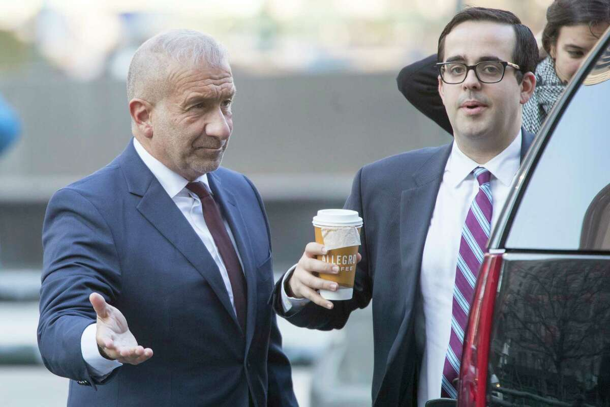Alain Kaloyeros, left, the ex-president of the State University of New York's Polytechnic Institute, arrives for his sentencing at Manhattan Federal court, Tuesday, Dec. 11, 2018, in New York. Kaloyeros, who led the Polytechnic Institute until he resigned in October 2016, was convicted in July of conspiracy and wire fraud after prosecutors presented evidence that the bidding process for a state project was rigged to benefit a Buffalo developer and a Syracuse development company.