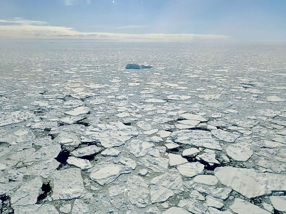 Disappearing sea ice along Greenland's coast in April. The Arctic has been warmer in the past five years than at any time in the modern era. The effects are felt far beyond the region. Photo: Joe Macgregor/NASA Icebridge / New York Times