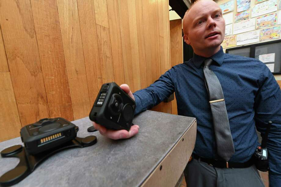 Lt. Michael McLaughlin, administrative services/technology, who was directly involved in the purchase of the units demonstrates one of the Panasonic MK3 Arbitrator Body Cams which has been which was chosen for the members of the Schenectady Police Department after an exhaustive study of many of the body cam units Tuesday Dec. 11, 2018 in Schenectady, N.Y.  (Skip Dickstein/Times Union) Photo: SKIP DICKSTEIN, Albany Times Union / 20045688A