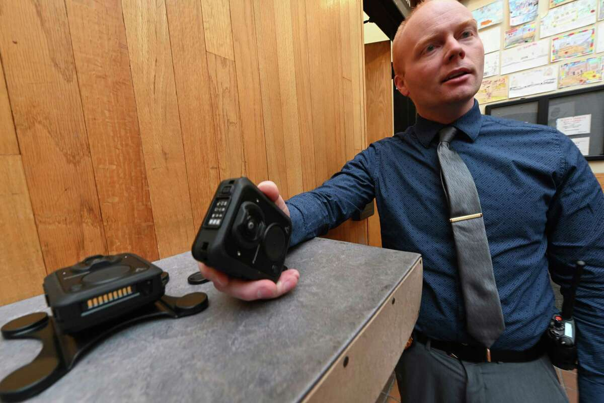 Lt. Michael McLaughlin, administrative services/technology, who was directly involved in the purchase of the units demonstrates one of the Panasonic MK3 Arbitrator Body Cams which has been which was chosen for the members of the Schenectady Police Department after an exhaustive study of many of the body cam units Tuesday Dec. 11, 2018 in Schenectady, N.Y. (Skip Dickstein/Times Union)