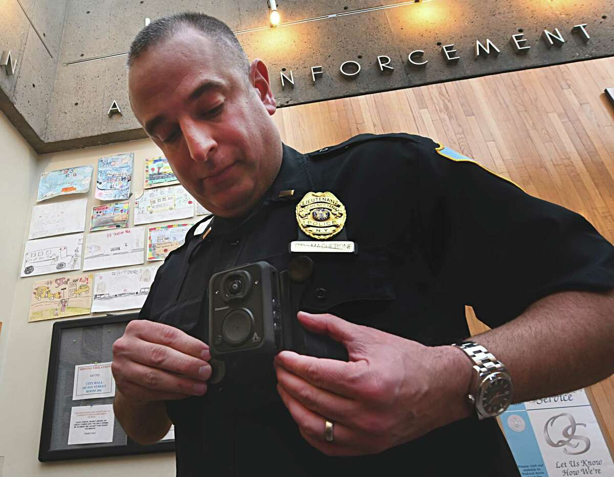 Lt. Ryan Macherone demonstrates the attachment of one of the Panasonic MK3 Arbitrator Body Cams which has been which was chosen for the members of the Schenectady Police Department after an exhaustive study of many of the body cam units Tuesday Dec. 11, 2018 in Schenectady, N.Y. (Skip Dickstein/Times Union)