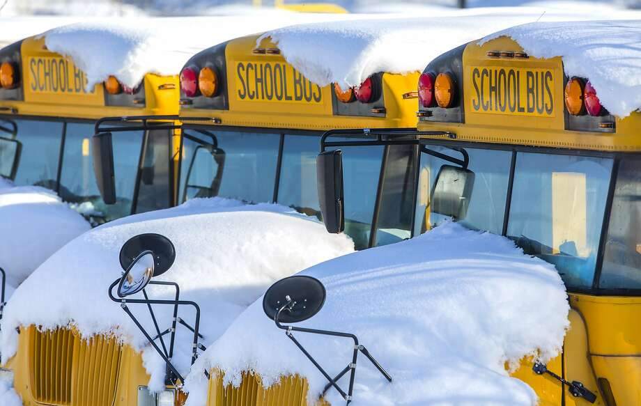School buses sit covered with snow in Greensboro, N.C. Sixty school districts remain closed after the storm dumped more than 2 feet of snow in western parts of the state. Photo: H. Scott Hoffmann / Associated Press