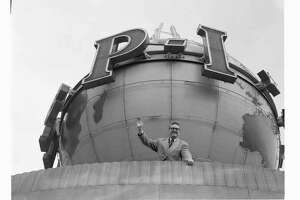 """Comedian Steve Allen waves from on top of the Seattle Post-Intelligencer building with the P-I's revolving globe looming behind him. Allen was in Seattle on a promotional tour for his syndicated television variety show, The Steve Allen Show, which aired from 1962 to 1964. A pioneer in television, he introduced man-on-the-street interviews and crazy stunts."" -MOHAI. Photo, dated Jan. 28, 1964, courtesy MOHAI, Seattle P-I Collection, image number 1986.5.17331.1."