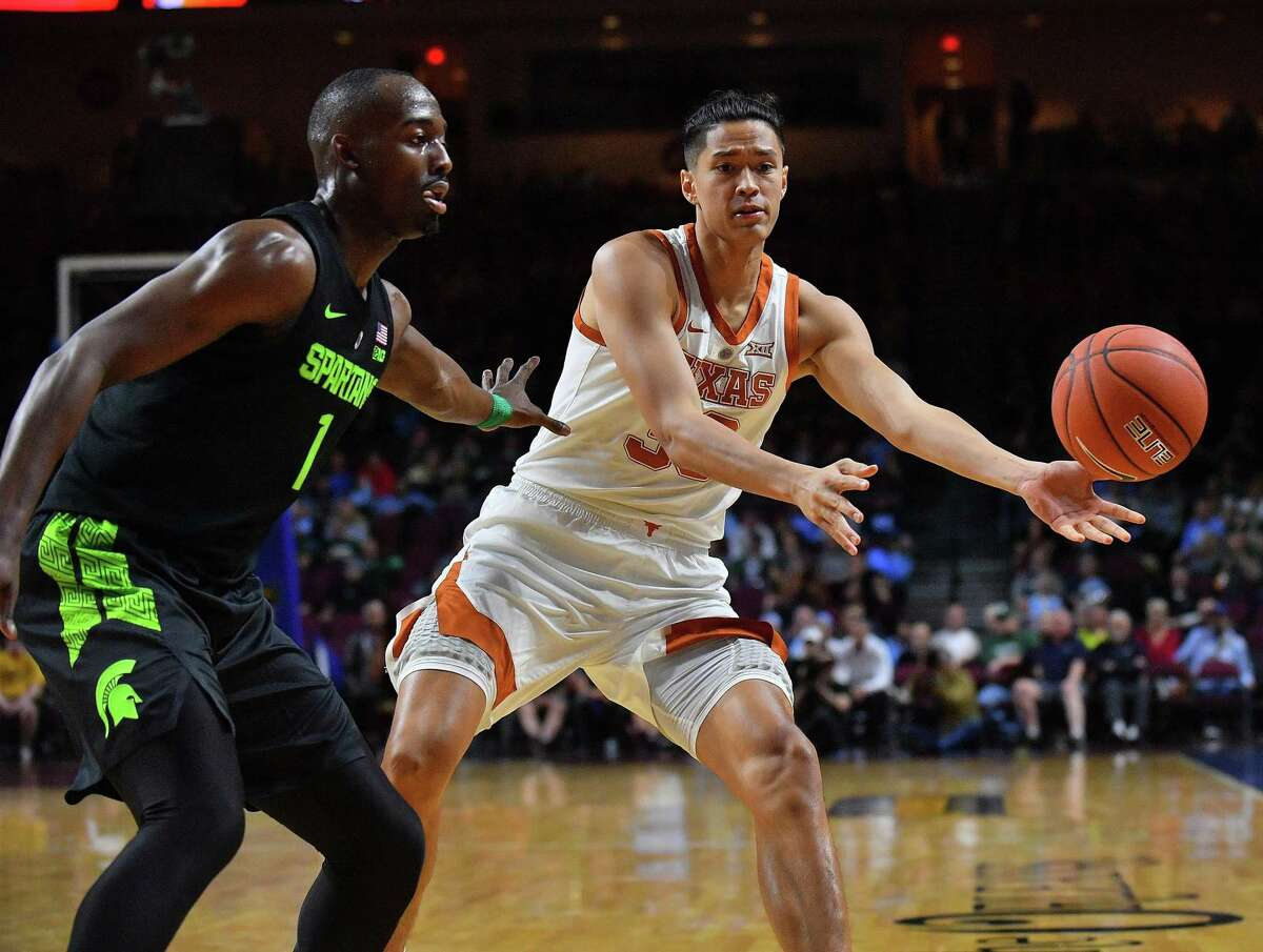 Kamaka Hepa #33 of the Texas Longhorns passes the ball against Joshua Langford #1 of the Michigan State Spartans during the championship game of the 2018 Continental Tire Las Vegas Invitational basketball tournament at the Orleans Arena on November 23, 2018 in Las Vegas.