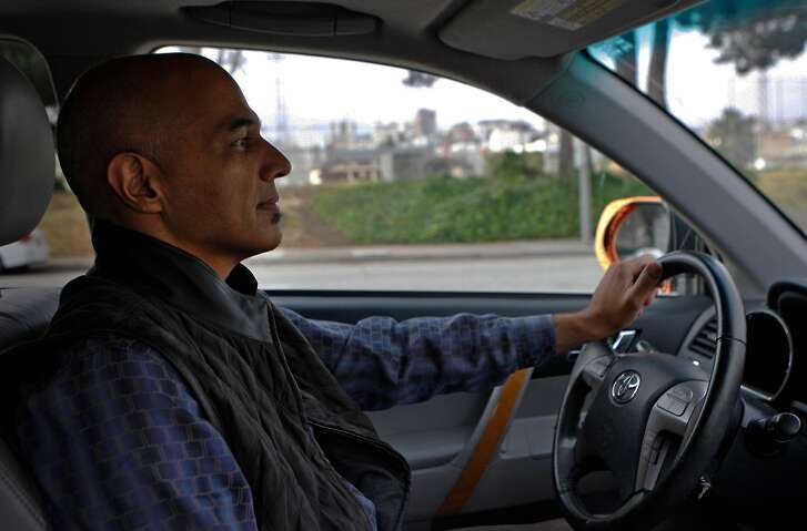 Sidecar co-founder and CEO Sunil Paul heads to the Marina in San Francisco, Calif. to pick up a Sidecar customer Friday, May 15, 2015. Paul regularly works as a driver, picking up passengers on his way to the Sidecar office where he runs the company.