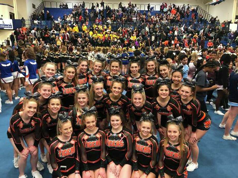 The Edwardsville High School varsity cheerleading team poses during the North Pole Cheer Invite at Lincoln-Way East High School in Frankfort, Illinois hosted on Saturday. Photo: Photos For The Intelligencer