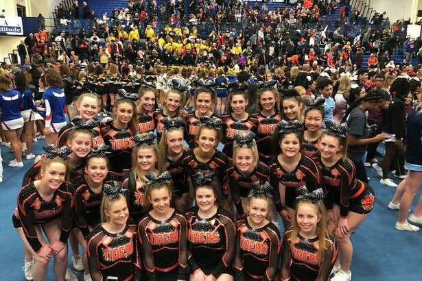 The Edwardsville High School varsity cheerleading team poses during the North Pole Cheer Invite at Lincoln-Way East High School in Frankfort, Illinois hosted on Saturday.