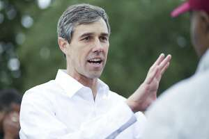 U.S. Senator Democrat candidate Beto O'Rourke talks with voters at Northeast Multi-Service Center on the first day of early voting in Texas on Monday, Oct. 22, 2018 in Houston.