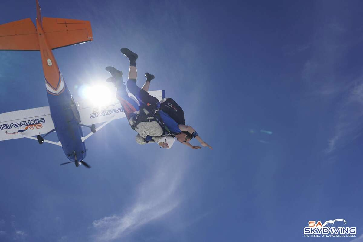 In this Dec. 9, 2018 photo, Irene O'Shea, bottom, skydives in Australia. A 102-year-old woman has completed a world record charity skydive in the Australian state of South Australia. Irene O'Shea became the oldest female skydiver on Sunday when she took part in the jump in the town of Langhorne Creek.