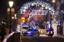 A police car drives in the streets of Strasbourg, eastern France, after a shooting breakout, on December 11, 2018. - A shooting in Strasbourg made one death and ten blessings, according to a new balance sheet.