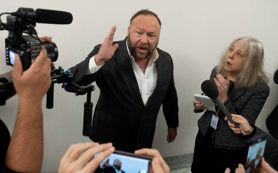 FILE-- Conservative commentator Alex Jones speaks outside the hearing room prior to testimony by Google CEO Sundar Pichai during a House Judiciary Committee hearing on Capitol Hill in Washington, DC, Dec. 11, 2018. The conspiracy extremist being sued for defamation by Sandy Hook families was ordered by a judge on Friday to turn over marketing and business records from his Infowars internet program. Photo: SAUL LOEB/AFP/Getty Images