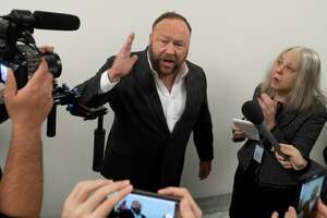 """Conservative commentator Alex Jones speaks outside the hearing room prior to testimony by Google CEO Sundar Pichai during a House Judiciary Committee hearing on Capitol Hill in Washington, DC, December 11, 2018. - Google chief executive Sundar Pichai was grilled by US lawmakers over allegations of """"political bias"""" by the internet giant, concerns over data security and its domination of internet search."""