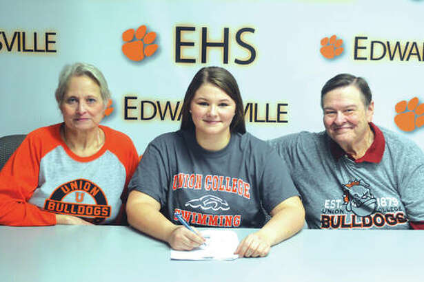 "Edwardsville senior Maggie Heinrich will swim at Union College, an NAIA school in Barbourville, Ky. From left to right are mother Lynne Heinrich, Maggie Heinrich and father Kurt Heinrich. ""I'm excited because there is so much culture at Union College that I didn't experience at the other schools,"" said Heinrich, who took off the past year from swimming to concentrate on academics. ""It felt like a home away from home."" Heinrich swam at EHS during her freshman and sophomore years and swam nine years for the Edwardsville YMCA Breakers before swimming for three years for FAST (Flyers Aquatic Swim Team) in St. Louis. At Union College, Heinrich will major in biology on a pre-medicine track."