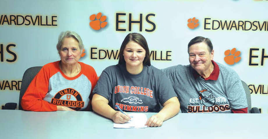 "Edwardsville senior Maggie Heinrich will swim at Union College, an NAIA school in Barbourville, Ky. From left to right are mother Lynne Heinrich, Maggie Heinrich and father Kurt Heinrich. ""I'm excited because there is so much culture at Union College that I didn't experience at the other schools,"" said Heinrich, who took off the past year from swimming to concentrate on academics. ""It felt like a home away from home."" Heinrich swam at EHS during her freshman and sophomore years and swam nine years for the Edwardsville YMCA Breakers before swimming for three years for FAST (Flyers Aquatic Swim Team) in St. Louis. At Union College, Heinrich will major in biology on a pre-medicine track. Photo: Scott Marion/Intelligencer"