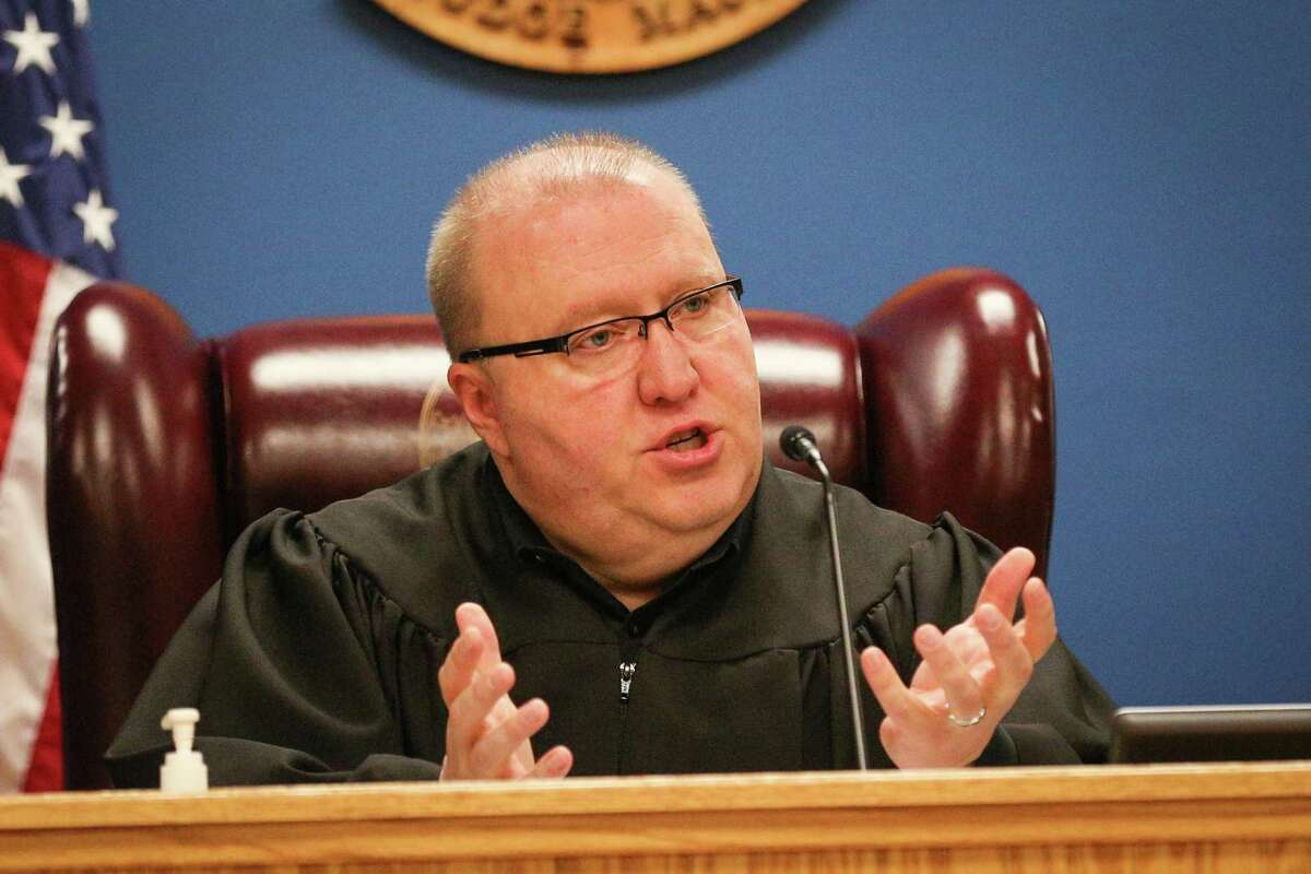 Montgomery County Judge Wayne Mack, Precinct 1 Justice of the Peace, presides in 2018 at the Montgomery County West Annex. A federal judge has ruled against Mack's practice of opening his court with a prayer said by a member of a volunteer chaplain program.