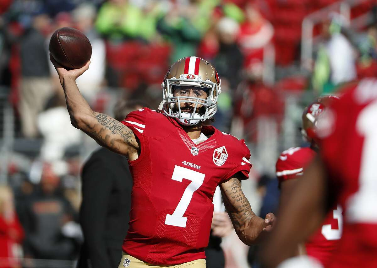 FILE - In this Jan. 1, 2017 file photo, San Francisco 49ers quarterback Colin Kaepernick (7) warms up before an NFL football game against the Seattle Seahawks in Santa Clara, Calif. Washington Redskins coach Jay Gruden says the team