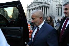 Alain Kaloyeros leaves the federal courthouse in Manhattan after he was sentenced on Tuesday, Dec. 11, 2018, to three and a half years in prison for his role in a bid-rigging scandal. Kaloyeros, the central architect of Gov. Andrew Cuomo's largest economic development efforts, was convicted in July of conspiring to steer hundreds of millions of dollars in state contracts to favored firms in Buffalo and Syracuse.