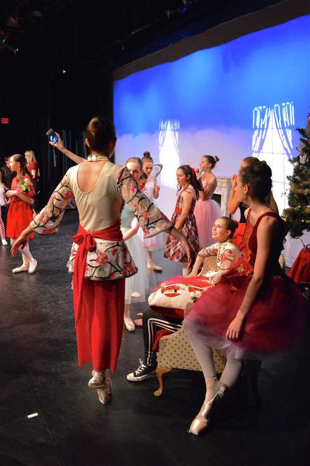 "In between performances the dancers stretch and socialize at the Darien Arts Center's performance of ""Scenes from The Nutcracker,"" Saturday, Dec. 8, 2018, in Darien, Conn. Photo: Jarret Liotta / For Hearst Connecticut Media / Darien News Freelance"
