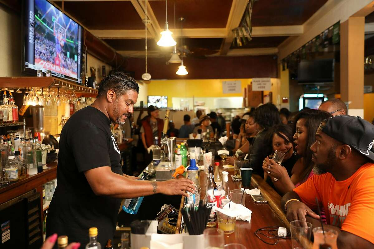 Andre Goodall (left), bartender at retirement party for Cassie Nickelson, 80-year-old owner/chef of Scend's restaurant as seen in Emeryville, California on Saturday, July 22, 2017. Marshawn Lynch of the Oakland Raiders is planning to take over the restaurant sometime in the next month.