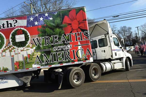 One of a convoy of Wreaths Across America trucks from Maine carrying over 250,000 donated wreaths headed to Arlington National Cemetery pulls into the Branford Fire Department on December 11, 2018 for a ceremony and wreath presentation.
