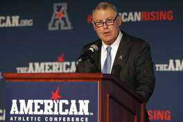 AAC Commissioner Mike Aresco addresses the media during an NCAA football media day in Newport, R.I.