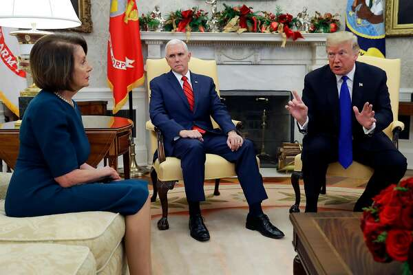 President Donald Trump and Vice President Mike Pence meet with House Minority Leader Nancy Pelosi, D-Calif., left and Senate Minority Leader Chuck Schumer, D-N.Y., not shown, in the Oval Office of the White House, Tuesday, Dec. 11, 2018, in Washington. (AP Photo/Evan Vucci)