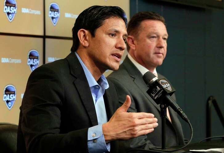 Dash managing director Brian Ching speaks as new head coach James Clarkson listens during a press conference announcing Clarkson as the new head coach of the Dash at BBVA Compass Stadium Tuesday, Dec. 11, 2018 in Houston, TX.