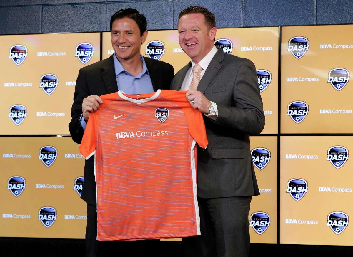 Dash managing director Brian Ching and new head coach James Clarkson hold a Dash jersey during a press conference announcing Clarkson as the new head coach of the Dash at BBVA Compass Stadium Tuesday, Dec. 11, 2018 in Houston, TX.