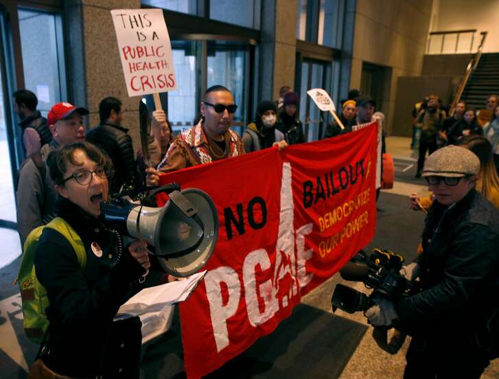About 20 activists occupy the PG&E lobby demanding the utility be held responsible for igniting the Camp Fire as a result of faulty equipment in San Francisco, Calif. on Tuesday, Dec. 11, 2018.