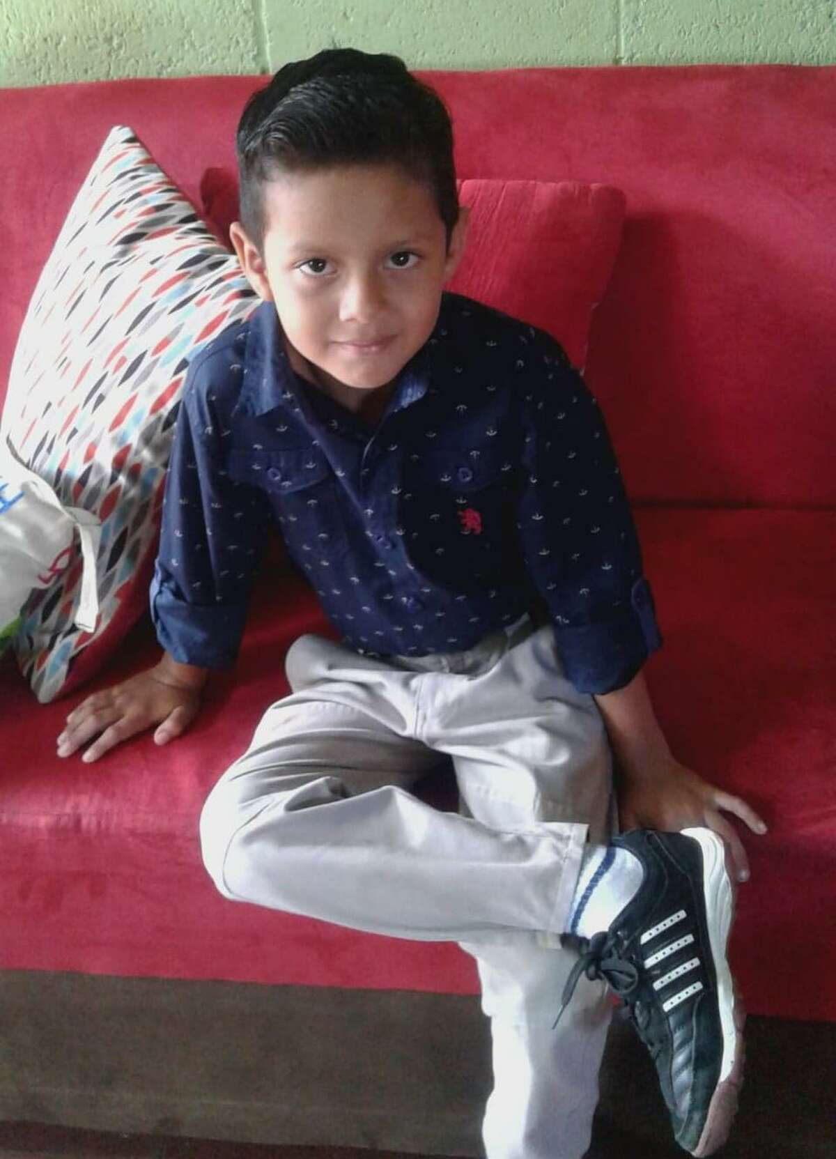Carlos, 7, is pictured here in El Salvador. The boy and his sister are in government custody after they were separated from their father at the border when the government accused him of being in a gang. The father denies it, saying he fled El Salvador because he was being targeted by gang members who tried to extort him.
