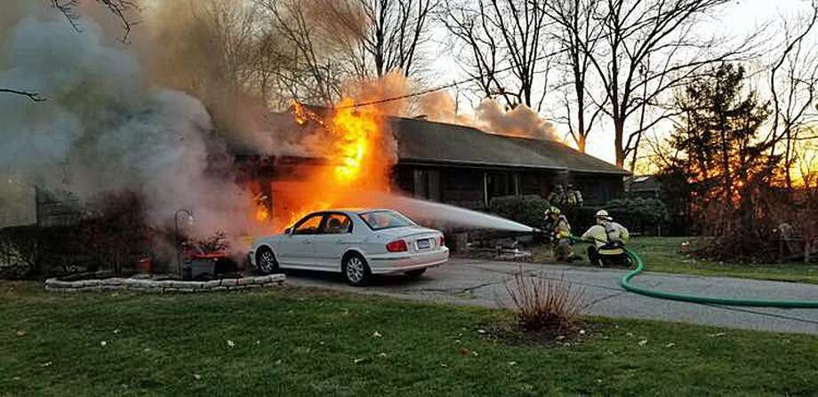 Trumbull, Conn., fire units responded to Hedgehog Road, near the intersection with Hedgehog Circle, around 4 p.m. on Dec. 11, 2018, for a garage fire. Photo: Contributed Photo / Trumbull Volunteer Fire Department / Contributed Photo / Connecticut Post Contributed