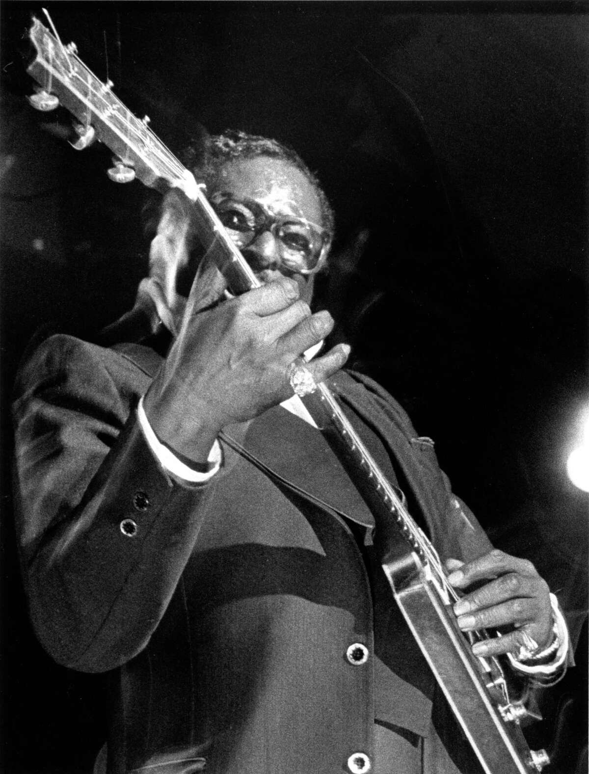 02/1984 - Bluesman Albert King, The Velvet Bulldozer, performs at Fitzgerald's with his Flying V guitar.