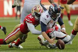 Denver Broncos quarterback Case Keenum recovers the ball after being brought down by San Francisco 49ers free safety D.J. Reed (32) during the second half of an NFL football game Sunday, Dec. 9, 2018, in Santa Clara, Calif. (AP Photo/Josie Lepe)