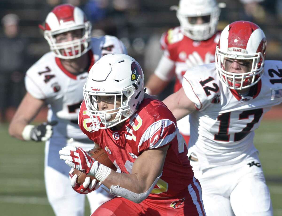 Greenwich's Tysen Comizio looks for room against New Canaan during the Class LL state championship game on Saturday at Boyle Stadium in Stamford. Teh Cardinals won 34-0 to cap a perfect season.