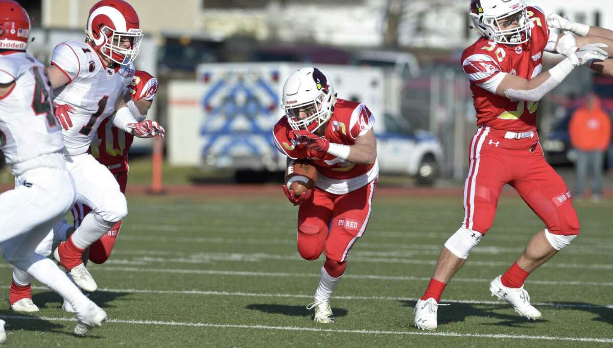 Greenwich's Lance Large finds plenty of room to run against New Canaan during the Class LL state championship game on Saturday at Boyle Stadium in Stamford.