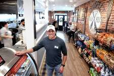 Chris Walsh, owner of Prospect Beach House Deli, in the eatery on Ocean Avenue in West Haven .