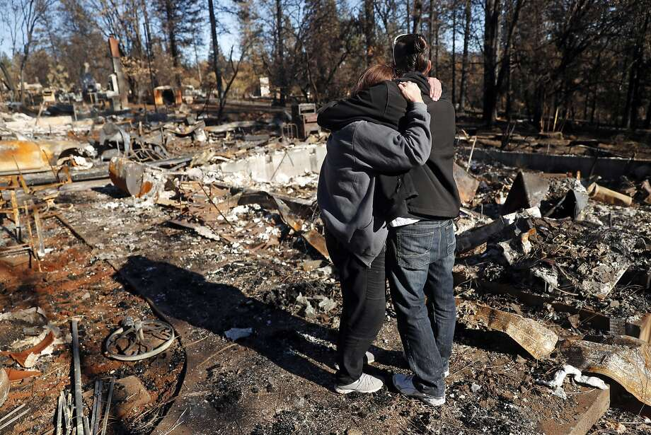 In the aftermath of the Camp Fire, Linda Haddock and her son, Jake Belculfino, embrace as they look through the remains of their house along Pentz Road in Paradise, Calif. on Thursday, December 6, 2018. Photo: Scott Strazzante / The Chronicle