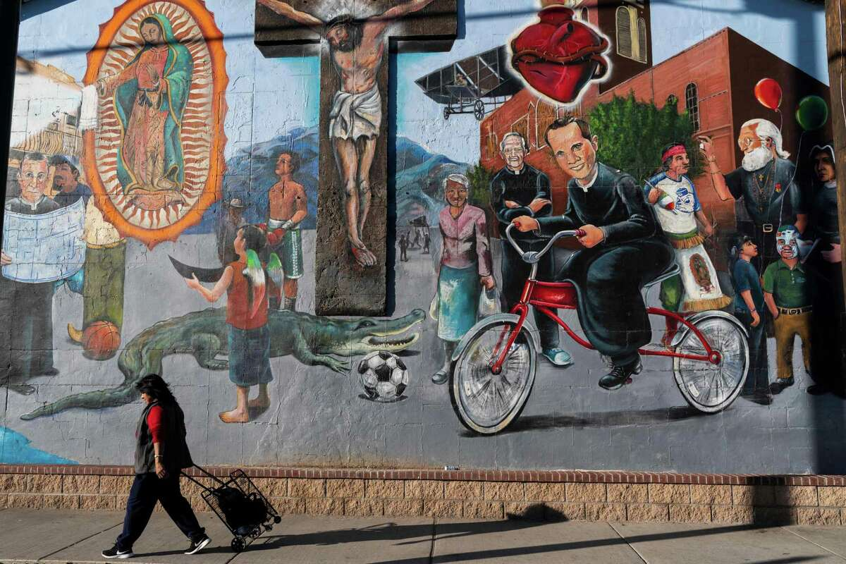 Sagrado Corazon, In El Paso, Texas on November 28, 2018, painted by Francisco Delgado and students from Bowie High School, depicts important characters in the history of El Pasos El Segundo Barrio, a neighborhood nestled directly on the US-Mexico border. - More than 100 murals are painted in the Lincoln Park and El Segundo districts of El Paso, Texas, depicting the city's Latino and Native American culture and community pride. (Photo by Paul Ratje / AFP) / RESTRICTED TO EDITORIAL USE - MANDATORY MENTION OF THE ARTIST UPON PUBLICATION - TO ILLUSTRATE THE EVENT AS SPECIFIED IN THE CAPTIONPAUL RATJE/AFP/Getty Images