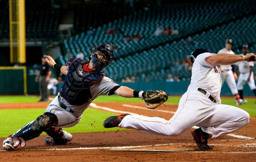 Houston Astros Brett Wallace slides past Minnesota Twins catcher Chris Herrmann to score a run during the first inning of a Major League Baseball game at Minute Maid Park Wednesday, Sept. 4, 2013, in Houston. (Cody Duty / Houston Chronicle)