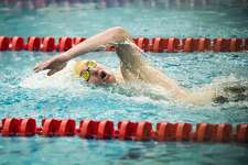 Dow sophomore Mark Van Heel competes in the 100 yard freestyle during the Pangborn Invitational on Tuesday, Dec. 11, 2018 at Saginaw Valley State University. (Katy Kildee/kkildee@mdn.net)