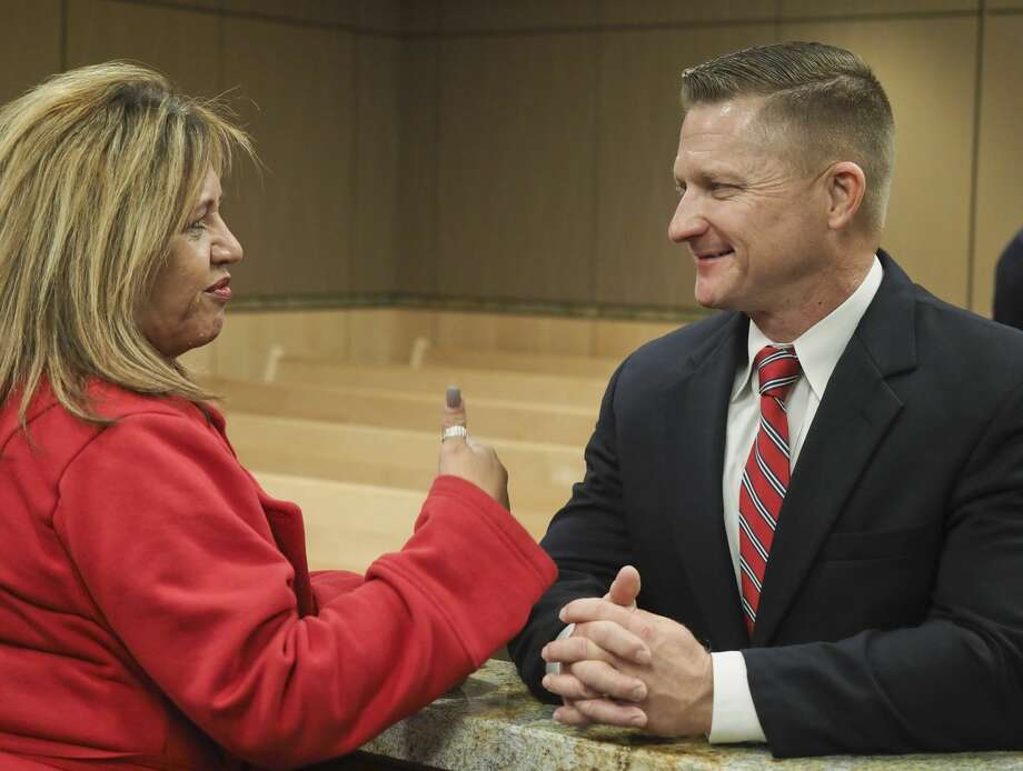 Rachel Stone talks with MPD Deputy Chief Seth Herman 12/11/18 evening at a community reception to talk with candidates for MPD chief at the Midland Municipal Courthouse. Tim Fischer/Reporter-Telegram Photo: Tim Fischer/Midland Reporter-Telegram