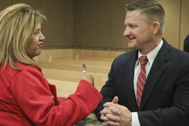 Rachel Stone talks with MPD Deputy Chief Seth Herman 12/11/18 evening at a community reception to talk with candidates for MPD chief at the Midland Municipal Courthouse. Tim Fischer/Reporter-Telegram
