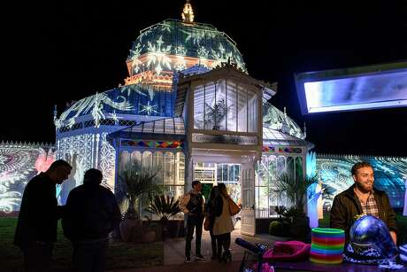 "Guests mingle outside the new ""Night Bloom"" installation at the San Francisco  Conservatory of Flowers in San Francisco, California, on Friday, November 30, 2018."