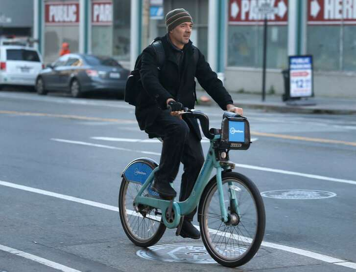 A commuter rides a Bay Area BikeShare bicycle on Townsend Street near the Caltrain station in San Francisco, Calif. on Thursday, March 2, 2017. A study reports that San Francisco is one of the worst big cities for bike-sharing.