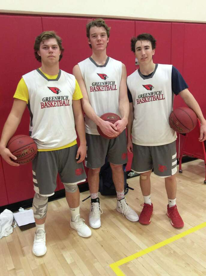 From left to right: Gavin Muir, Oliver Milledge and Billy Nail are senior captains on the Greenwich High School boys basketball team. Photo: David Fierro / Hearst Connecticut Media / Contributed Photo / Greenwich Time Contributed
