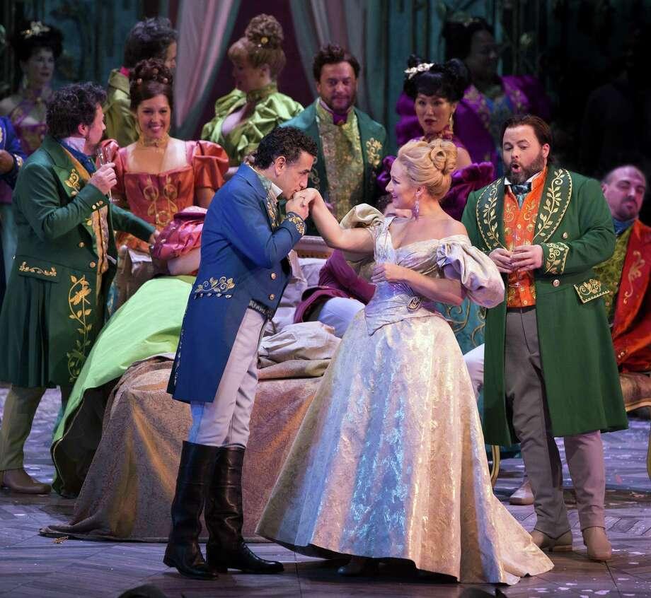 "The Warner Theatre's Met in HD series continues Dec. 29 with ""La Traviata."" Above, Juan Diego Flórez as Alfredo and Diana Damrau as Violetta. Photo: Metropolitan Opera / Contributed Photo / / Marty Sohl/The Metropolitan Opera"