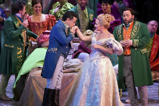 "The Warner Theatre's Met in HD series continues Dec. 29 with ""La Traviata."" Above, Juan Diego Flórez as Alfredo and Diana Damrau as Violetta."