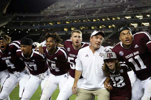 By virtue of the tiebreaker edge over LSU for second place, first-year Texas A&M coach Jimbo Fisher, third from right, guided the Aggies to their highest SEC West finish.